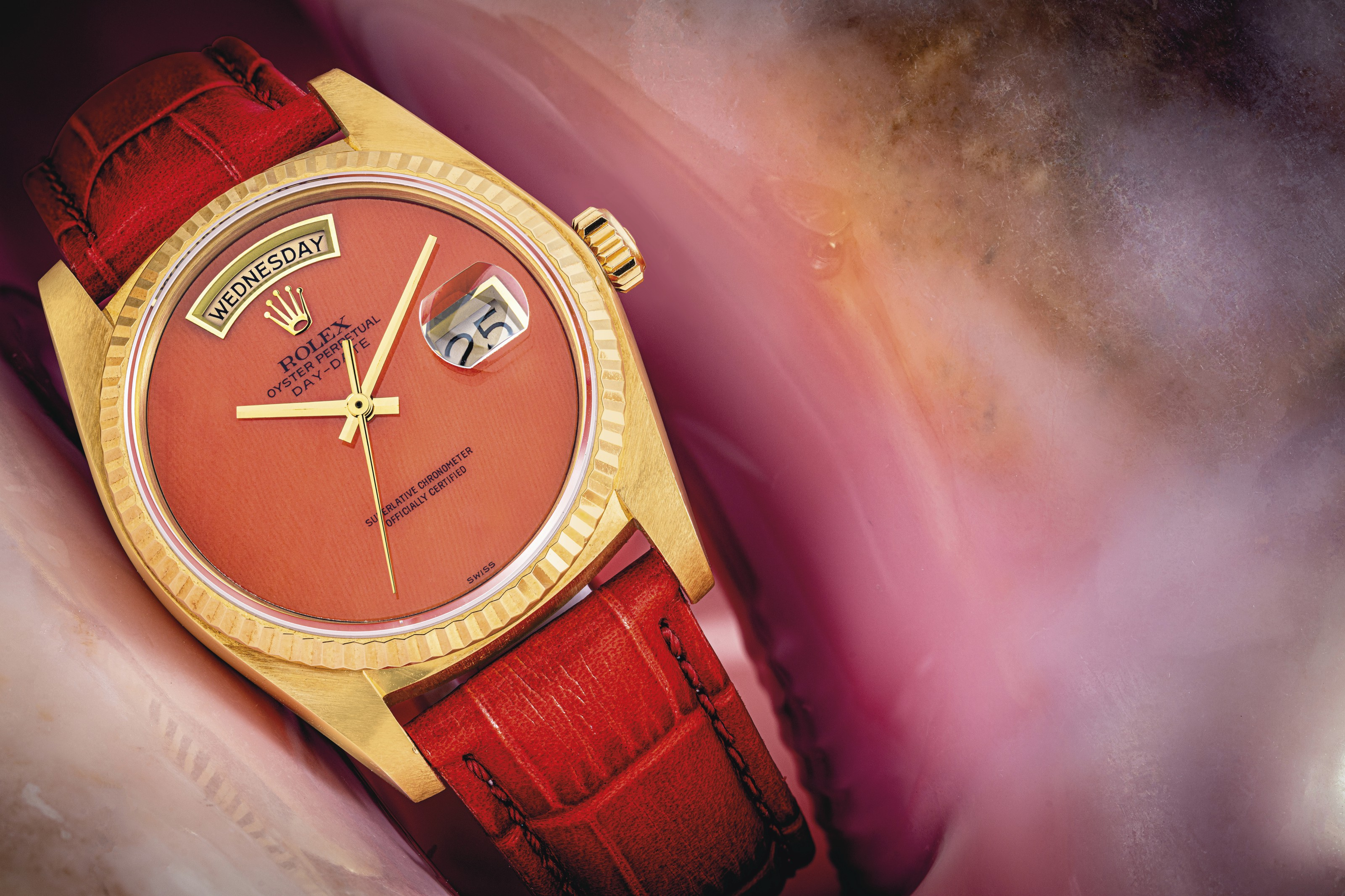 ROLEX. A VERY RARE 18K GOLD AUTOMATIC WRISTWATCH WITH SWEEP CENTRE SECONDS, DAY, DATE AND CORAL DIAL