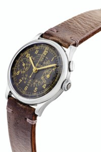 TISSOT. AN ATTRACTIVE STAINLESS STEEL CO-AXIAL SINGLE BUTTON CHRONOGRAPH WRISTWATCH WITH BLACK DIAL AND TELEMETER SCALE