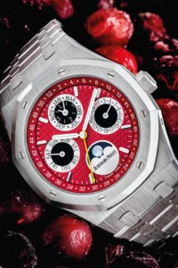 AUDEMARS PIGUET. AN EXTREMELY RARE 18K WHITE GOLD LIMITED EDITION AUTOMATIC PERPETUAL CALENDAR WRISTWATCH WITH MOON PHASES, LEAP YEAR INDICATION AND BRACELET WITH RED DIAL