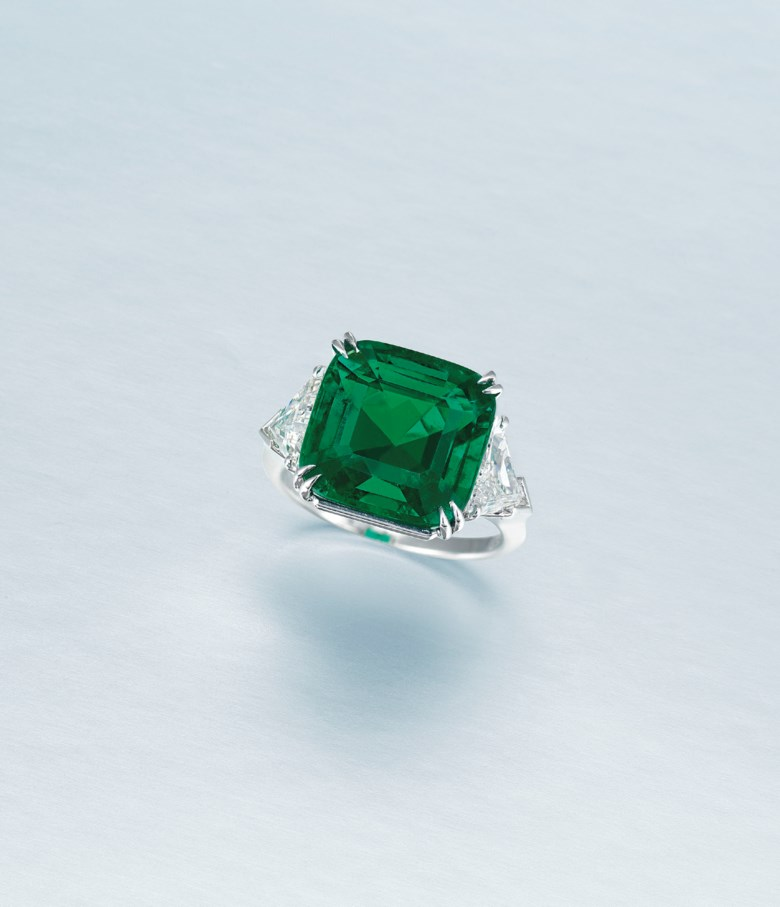 An important emerald and diamond ring, Harry Winston. Cushion-shaped emerald of 9.55 carats, triangular-cut diamonds, platinum, ring size 7¼, signed Winston, makers mark (Jacques Timey). Estimate HK$3,200,000-4,800,000. Offered in Hong Kong Magnificent Jewels on 9 July 2020 at Christie's in Hong Kong
