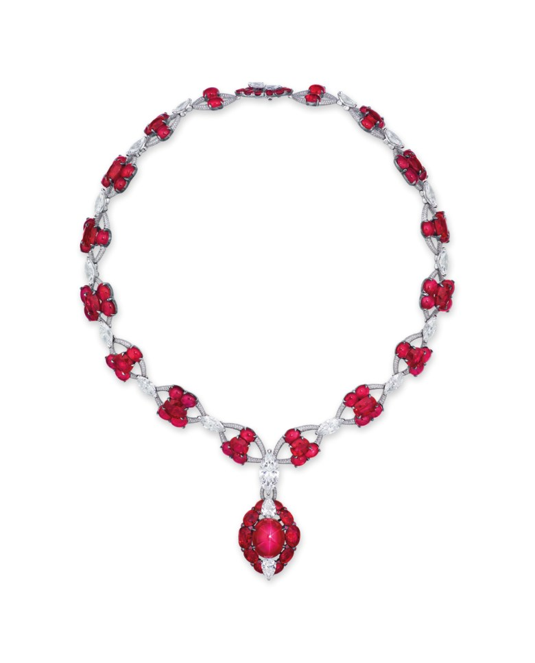 A magnificent star ruby and diamond necklace, Etcetera. Oval cabochon star ruby of 19.53 carats, oval cabochon rubies, oval and cushion-shaped rubies, 13 marquise-cut diamonds from 3.55 to 0.70 carats, two pear-shaped diamonds of 1.00 and 1.00 carats, circular-cut diamonds, gold, 38.2 cm, makers mark. Estimate HK$18,000,000-28,000,000. Offered in Hong Kong Magnificent Jewels on 9 July 2020 at