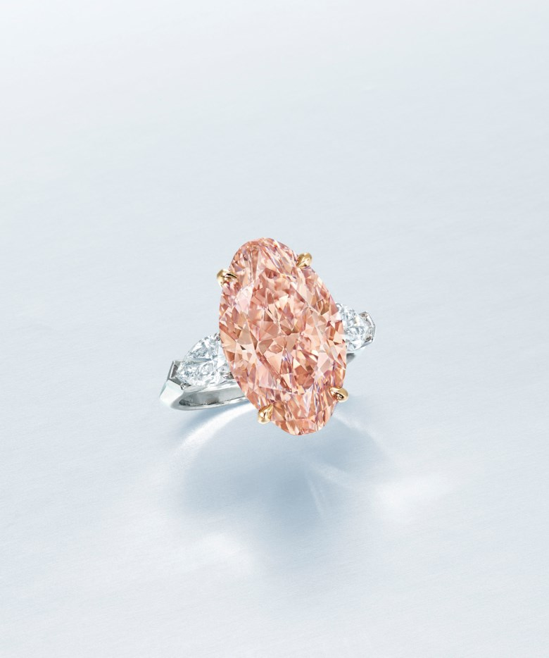 An important coloured diamond and diamond ring. Fancy brownish orangy pink oval modified brilliant-cut diamond of 8.04 carats, pear brilliant-cut diamonds of 0.50 and 0.50 carats, platinum and gold, ring size 5¾. Estimate HK$2,000,000-3,000,000. Offered in Hong Kong Magnificent Jewels on 9 July 2020 at Christie's in Hong Kong