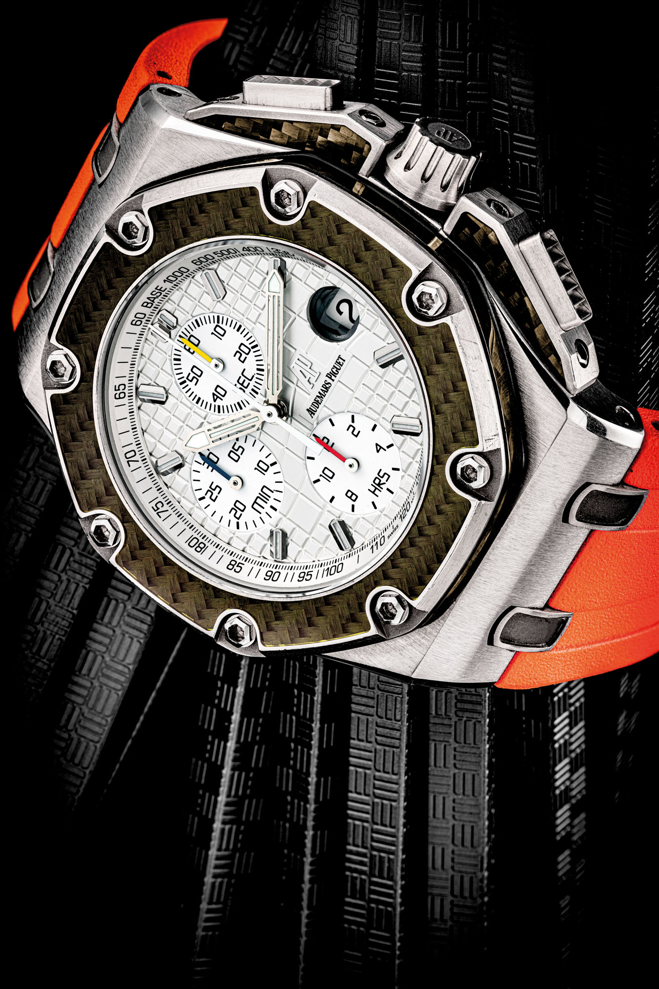 AUDEMARS PIGUET. A TITANIUM AND CARBON LIMITED EDITION AUTOMATIC CHRONOGRAPH WRISTWATCH WITH DATE