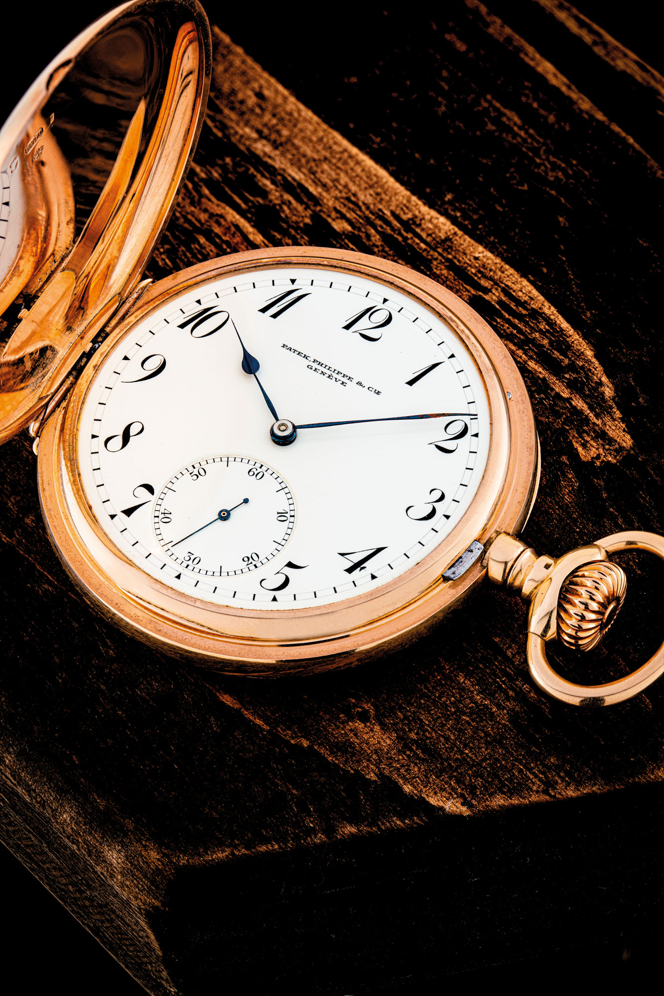 PATEK PHILIPPE. AN 18K PINK GOLD KEYLESS LEVER WATCH WITH ENAMEL DIAL AND BREGUET NUMERALS