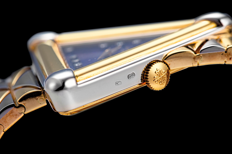 PATEK PHILIPPE. A FABULOUS AND POSSIBLY UNIQUE 18K TWO-COLOUR GOLD TRIANGULAR BRACELET WATCH WITH DIAMOND-SET LAPIS LAZULI DIAL