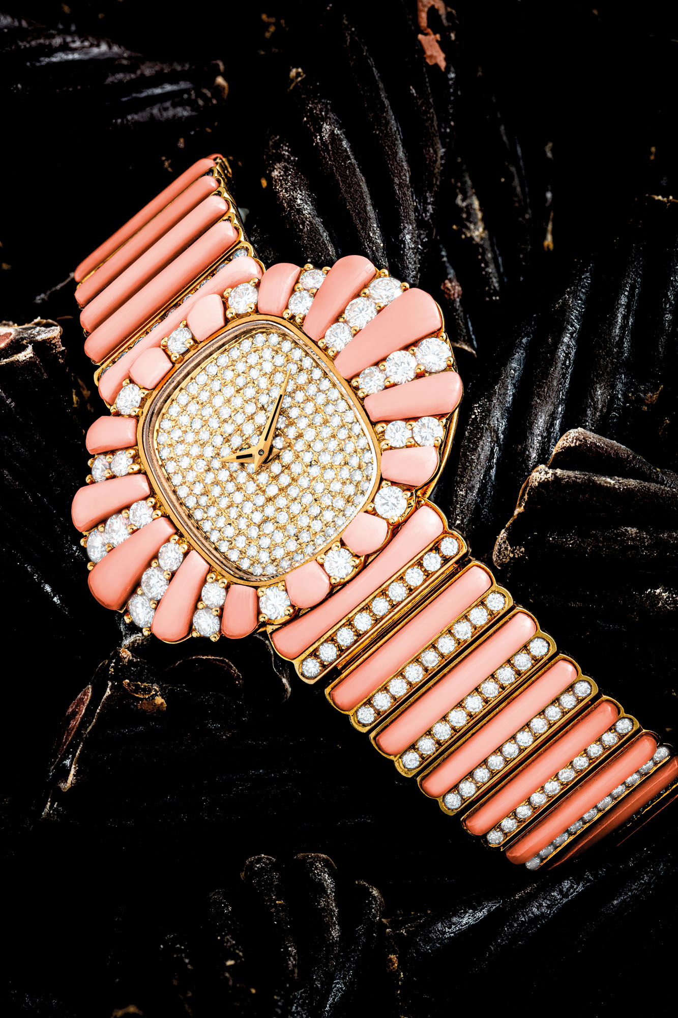 PATEK PHILIPPE. A LADY'S GORGEOUS AND POSSIBLY UNIQUE 18K GOLD AND DIAMOND-SET BRACELET WATCH WITH CORAL
