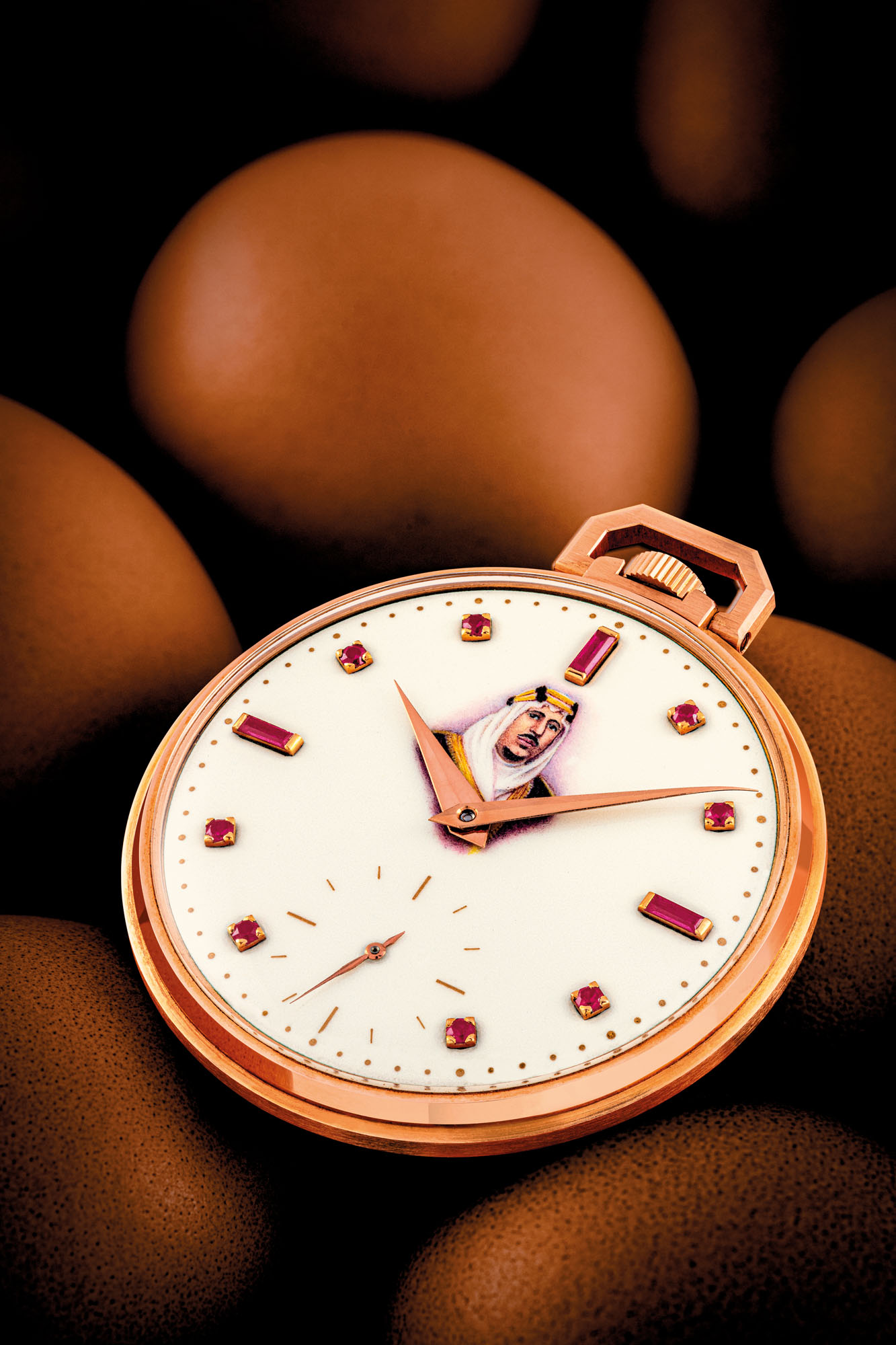 PATEK PHILIPPE. A VERY RARE 18K PINK GOLD OPENFACE KEYLESS LEVER WATCH WITH RUBY-SET ENAMEL DIAL WITH PAINTED PORTRAIT OF KING OF SAUDI ARABIA