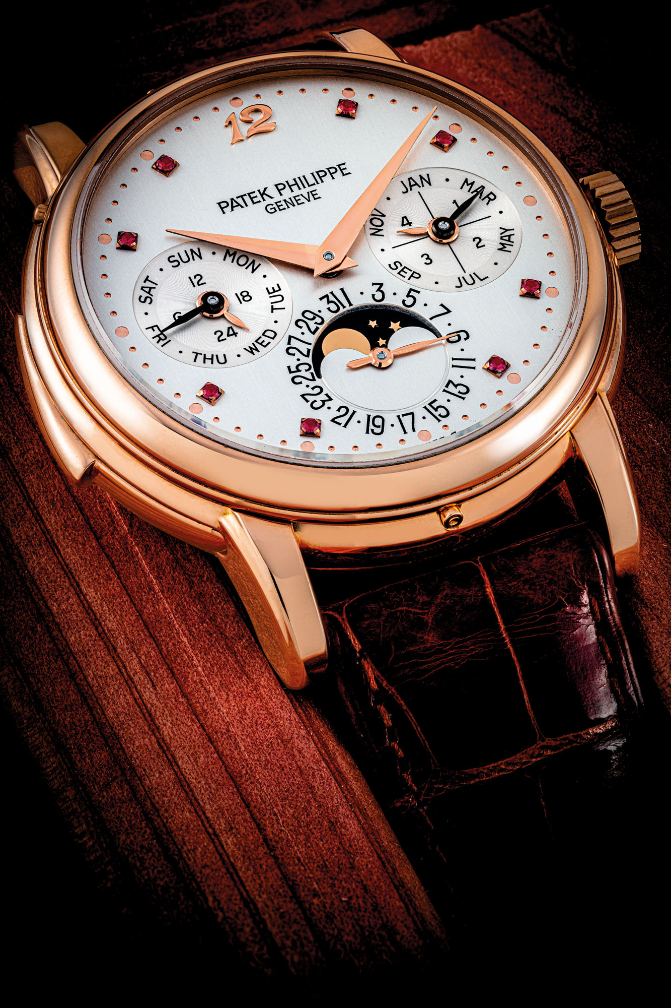 PATEK PHILIPPE. AN IMPORTANT AND POSSIBLY UNIQUE 18K PINK GOLD AUTOMATIC MINUTE REPEATING PERPETUAL CALENDAR WRISTWATCH WITH MOON PHASES, 24 HOUR AND LEAP YEAR INDICATION AND RUBY-SET DIAL