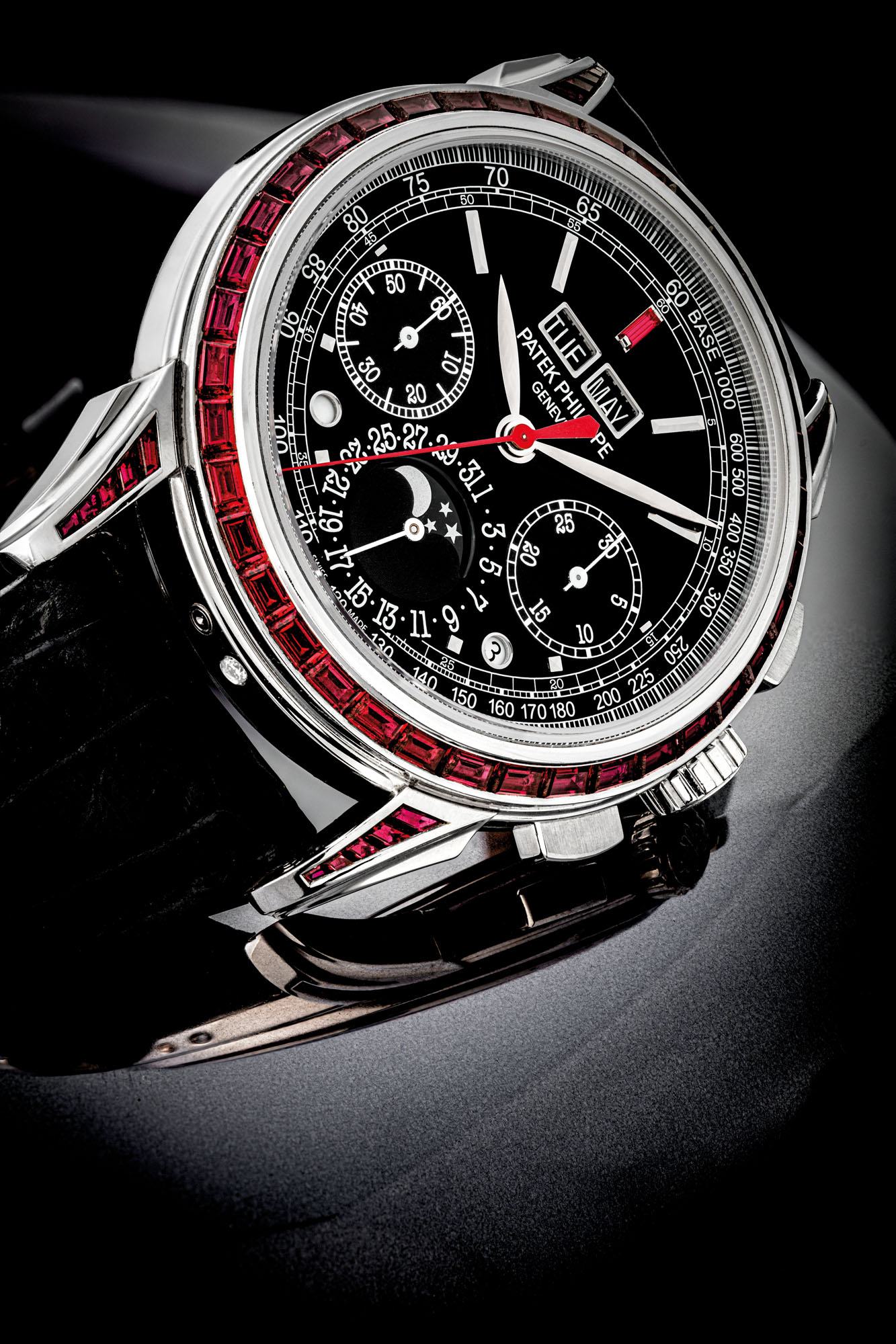 PATEK PHILIPPE. AN IMPRESSIVE AND VERY RARE PLATINUM AND RUBY-SET PERPETUAL CALENDAR CHRONOGRAPH WRISTWATCH WITH MOON PHASES, LEAP YEAR AND DAY/NIGHT INDICATION