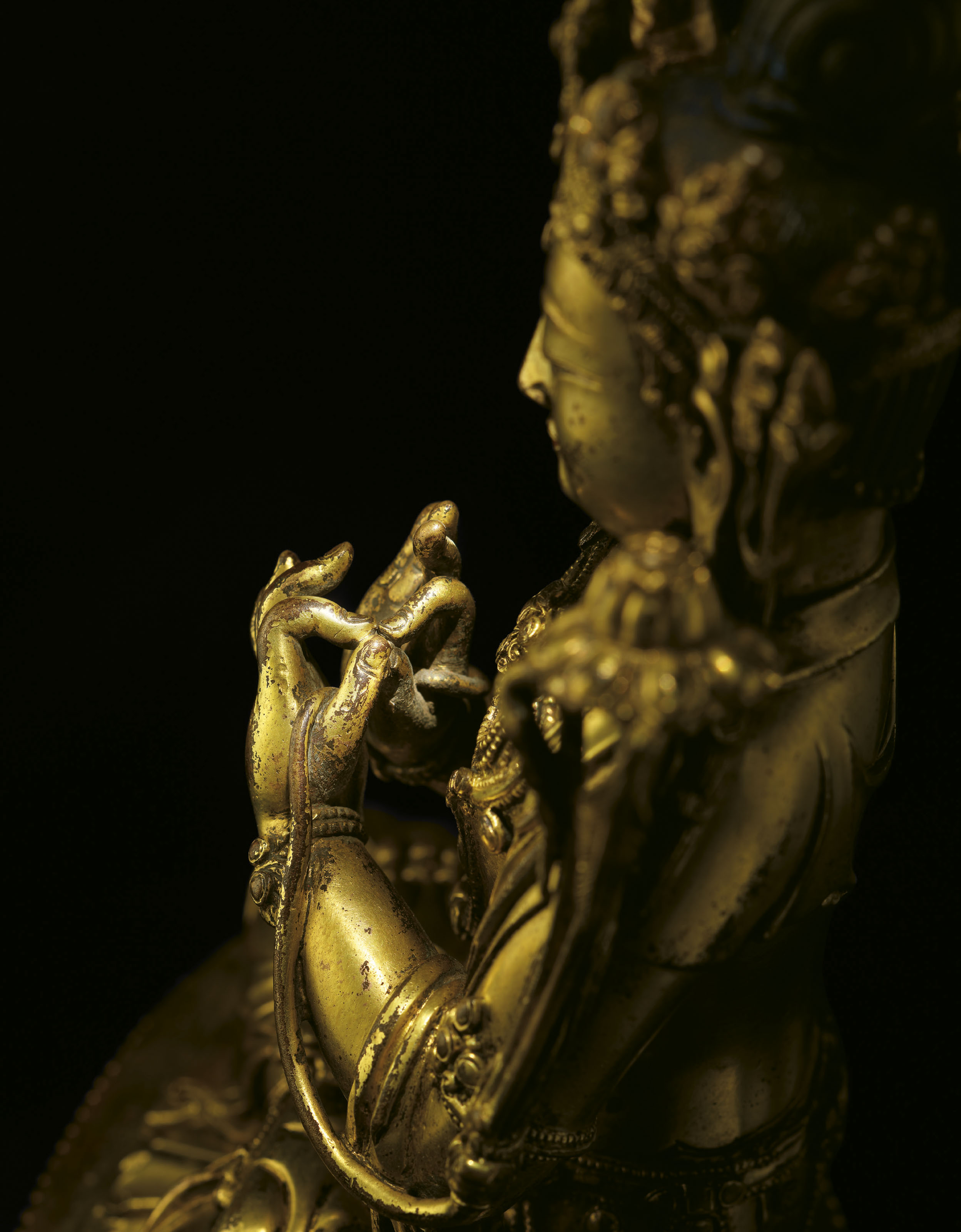 A VERY RARE AND FINELY CAST GILT-BRONZE FIGURE OF MAITREYA