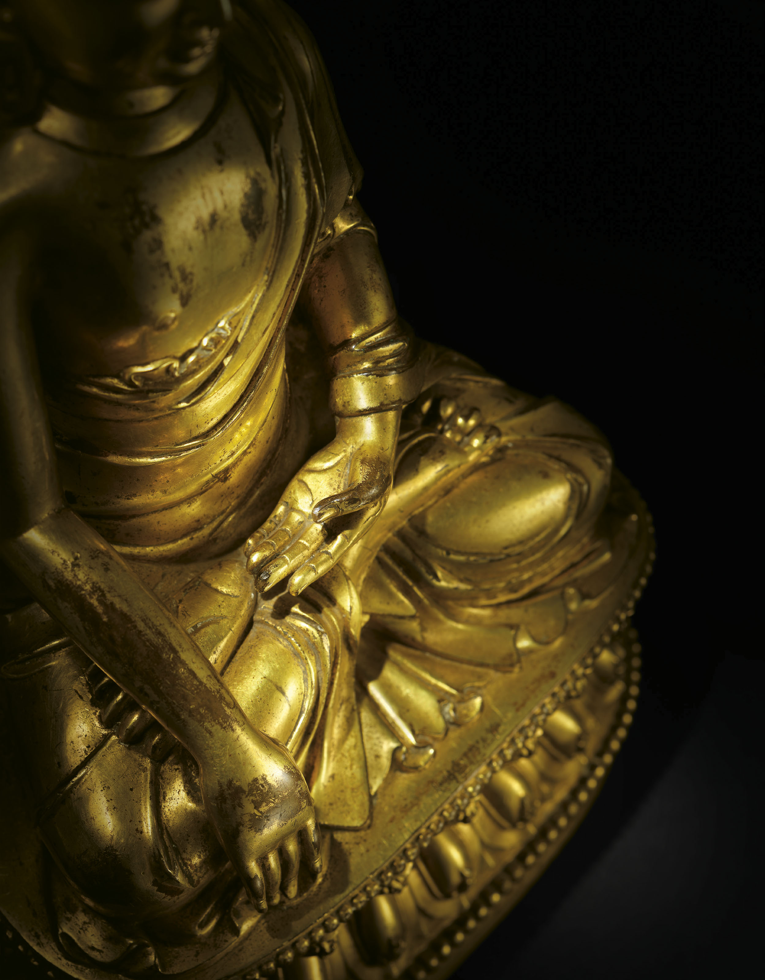 A VERY RARE AND SUPERB GILT-BRONZE FIGURE OF BUDDHA SHAKYAMUNI