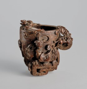 A CARVED ALOESWOOD 'DRAGON AND PHOENIX' LIBATION CUP