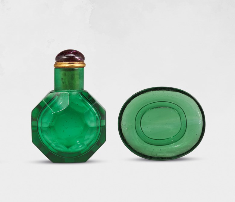 An emerald-green glass facetted snuff bottle, imperial workshops, Beijing, Qing dynasty, 1720-1820. Bottle 1⅗ in (4  cm) high, tourmaline stopper, dish 1⅖ in (3.7  cm) long. Estimate HK$16,000-30,000. Offered in Chinese Snuff Bottles and Matching Dishes from Private Collections on 8 October 2020 at Christie's in Hong Kong