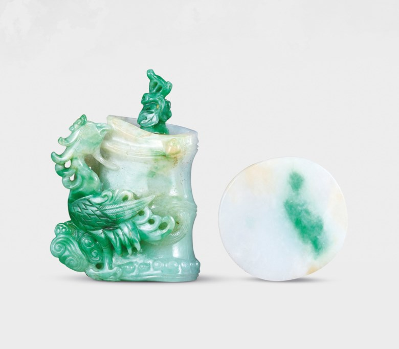 A jadeite 'phoenix and bamboo' snuff bottle, probably imperial, attributable to the palace workshops, Qing dynasty, 1770-1840. Bottle 2⅛  in (5.4  cm) high, jadeite stopper, dish 1⅝  in (4.2  cm) long. Estimate HK$160,000-300,000. Offered in Chinese Snuff Bottles and Matching Dishes from Private Collections on 8 October 2020 at Christie's in Hong Kong