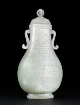 A WHITE JADE 'KUI DRAGON' VASE AND COVER