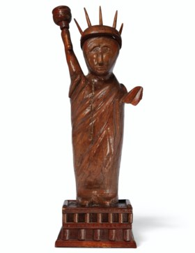 A CARVED PINE STATUE OF LIBERTY