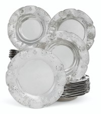 A SET OF TWENTY-ONE AMERICAN SILVER SOUP PLATES AND THIRTEEN MATCHING DINNER PLATES