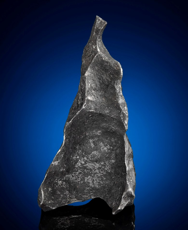 Gibeon meteorite, iron, Group IVA, fine octahedrite. Gibeon, Great Nama Land, Namibia. 140 x 73 x 77 mm (5.5 x 2.75 x 3 in). Estimate $3,000-5,000. Offered in Deep Impact Lunar and Rare Meteorites, 12-25 August 2020, Online
