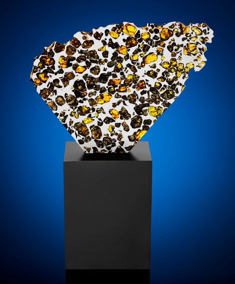 Extraterrestrial gems in a large partial slice of Esquel pallasite, Argentina. 163 x 207 x 3 mm (6.33 x 8 x 0.1 in). Estimate $15,000-25,000. Offered in Deep Impact Lunar and Rare Meteorites, 12-25 August 2020, Online