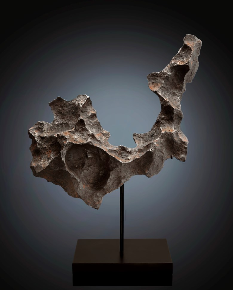 Gibeon meteorite,iron, Group IVA, fine octahedrite. Gibeon, Great Nama Land, Namibia. 309 x 274 x 93 mm (12.25 x 10.75 x 3.66 in). Estimate $50,000-80,000. Offered in Deep Impact Lunar and Rare Meteorites, 12-25 August 2020, Online