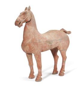 A LARGE PAINTED POTTERY FIGURE OF A HORSE