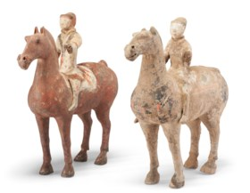 TWO PAINTED POTTERY FIGURES OF HORSES AND RIDERS