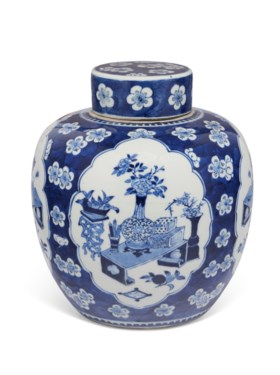 A BLUE AND WHITE JAR AND A COVER