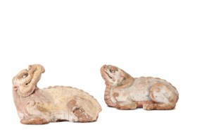 A PAIR OF PAINTED BAKED MUD FIGURES OF MYTHICAL BEASTS