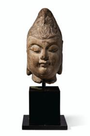 A CARVED MARBLE HEAD OF A BODH