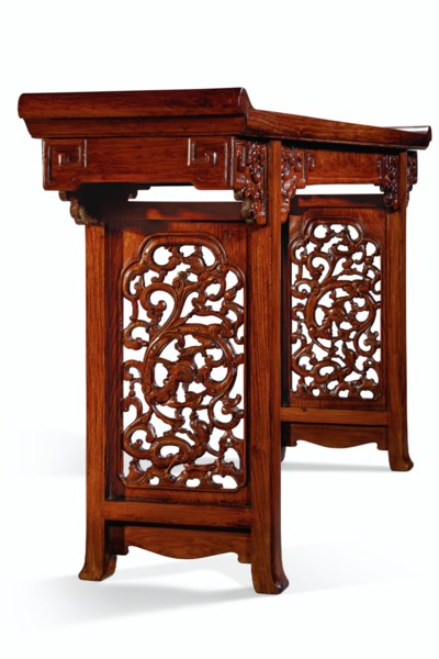 A HUANGHUALI TRESTLE-LEG TABLE