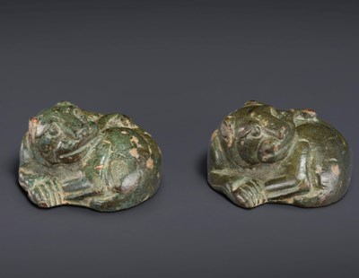 A PAIR OF BRONZE COILED TIGER-