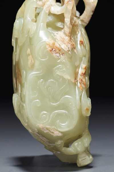 A FINELY CARVED GREENISH-YELLO