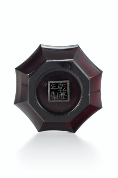 A TRANSLUCENT GARNET-RED GLASS