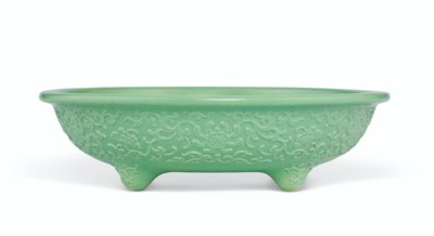A RARE RELIEF-DECORATED GREEN-