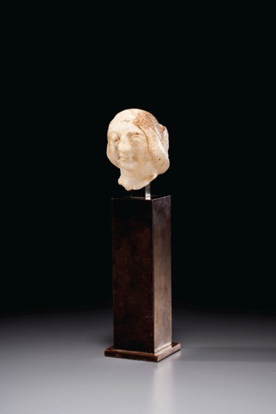 A SUMERIAN GYPSUM FEMALE HEAD