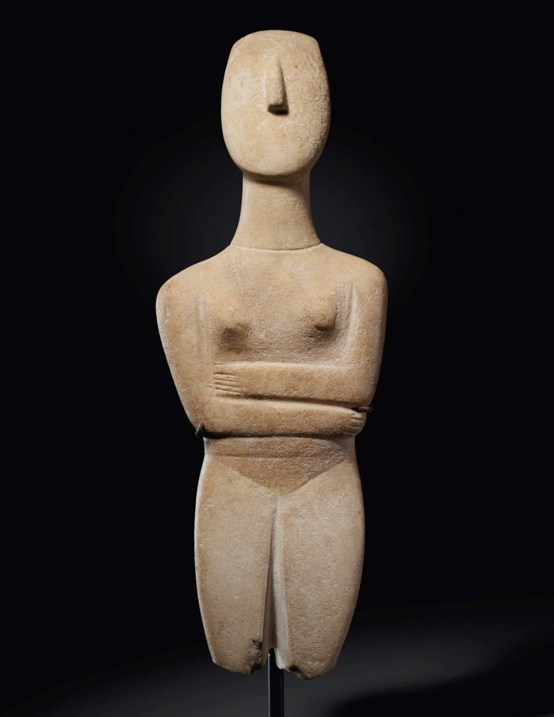 A Cycladic marble reclining female figure, late Spedos variety, early Cycladic II, circa 2500-2400 BC. 12½ in (31.7 cm) high. Estimate $700,000-900,000. Offered in Antiquities on 13 October 2020 at Christie's in New York