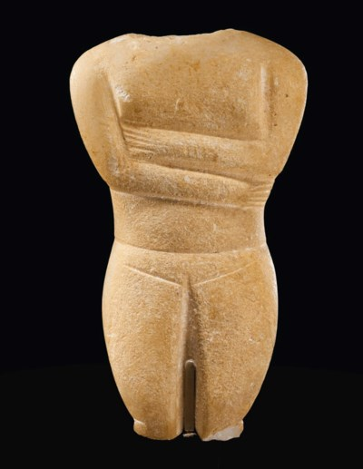 A CYCLADIC MARBLE FEMALE TORSO
