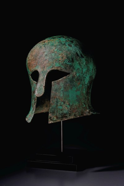 A GREEK BRONZE HELMET OF CORIN