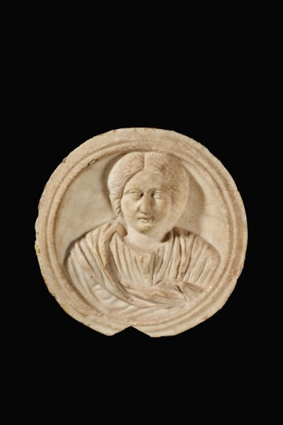 A ROMAN MARBLE CLIPEUS WITH A
