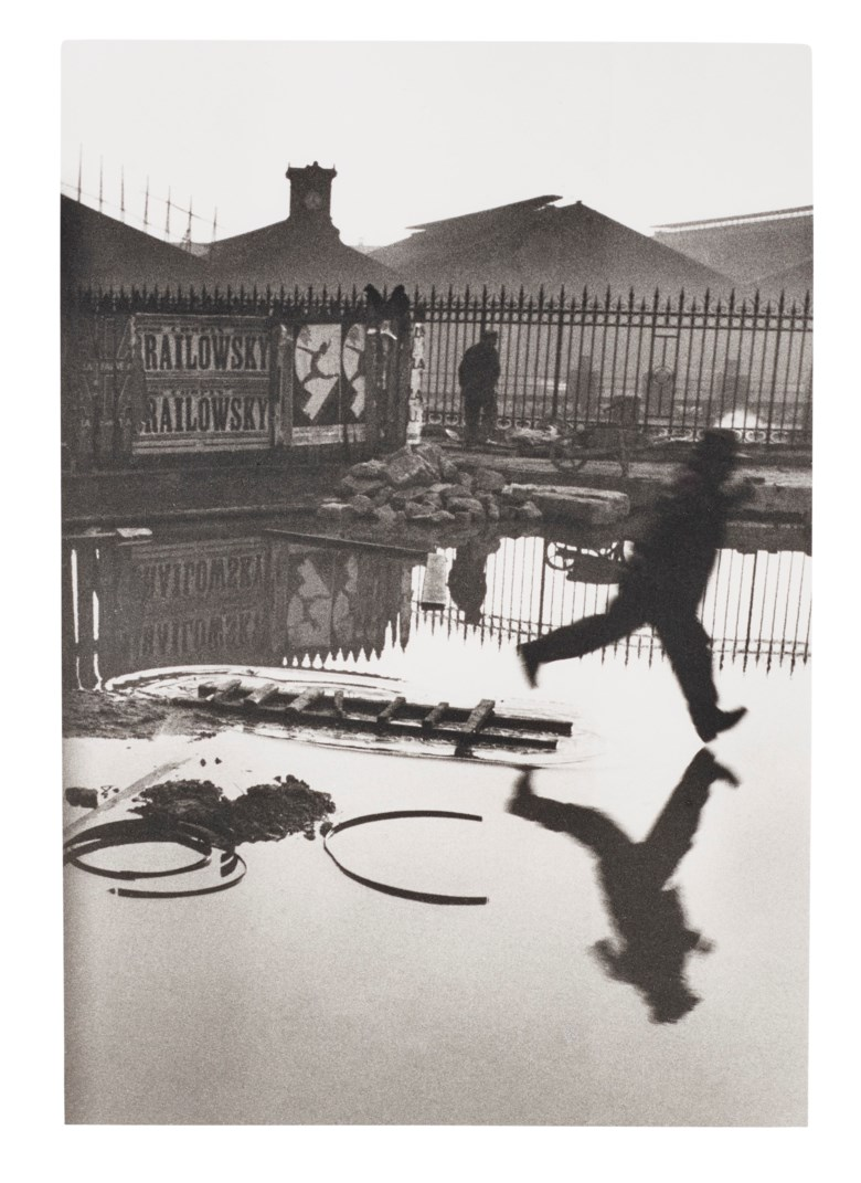 Henri Cartier–Bresson (1908–2004), Behind the Gare St. Lazare, Paris, 1932. Gelatin silver print, printed later. Sheet 16 x 12 in (40.6 x 30.4 cm). Estimate $10,000-15,000. Offered in  Photographs, 21-30 September 2020, Online