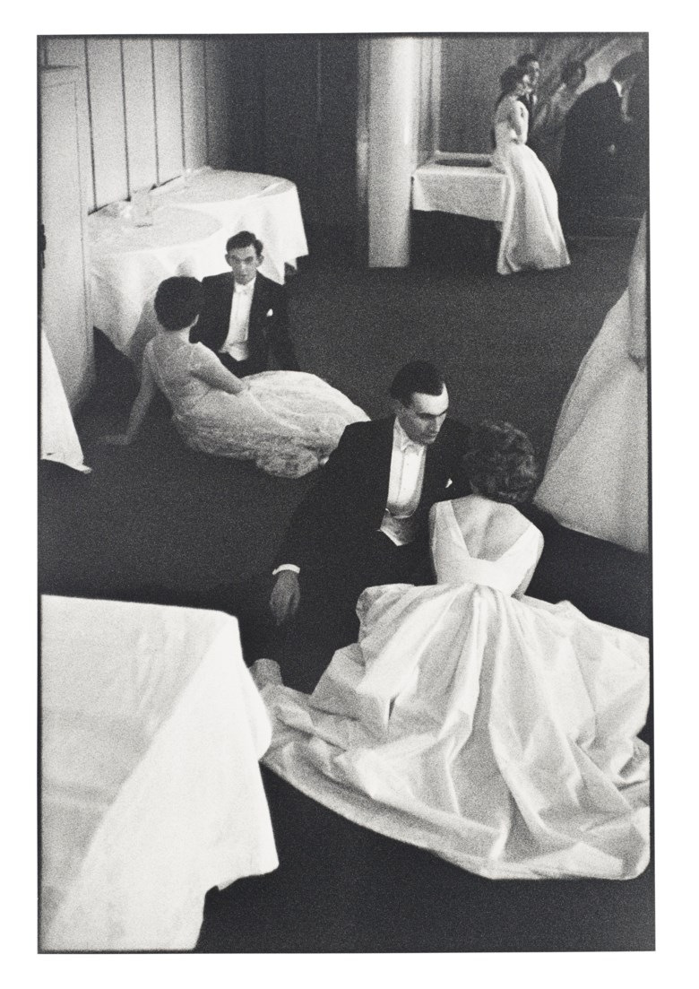 Henri Cartier–Bresson (1908–2004), Queen Charlottes Ball, London, England, 1959. Gelatin silver print, printed later. Sheet 19⅞ x 15¾ in (50.5 x 40 cm). Estimate $12,000-18,000. Offered in  Photographs, 21-30 September 2020, Online