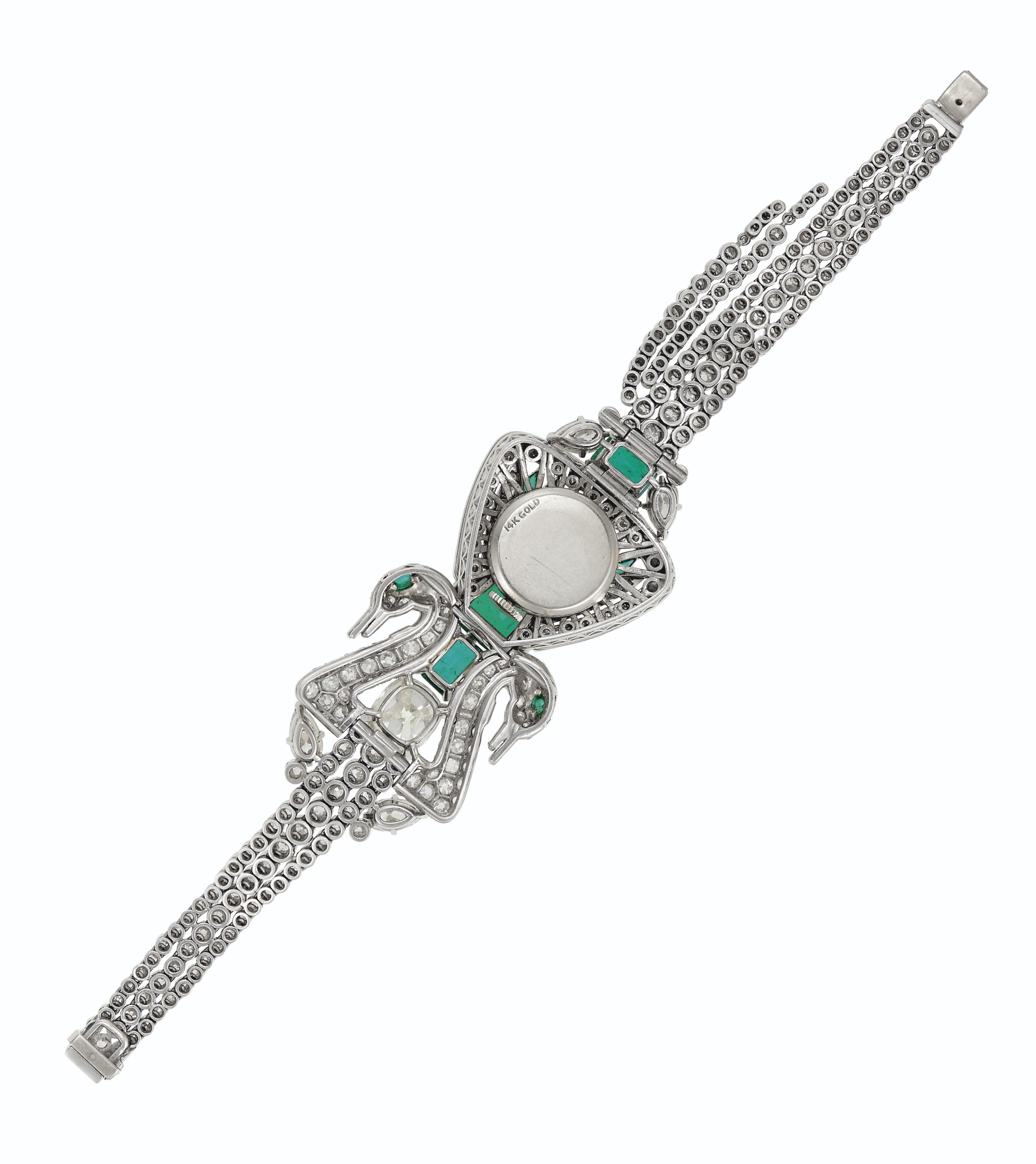 DIAMOND, EMERALD AND MULTI-GEM DOUBLE-SWAN CONCEALED WATCH-BRACELET