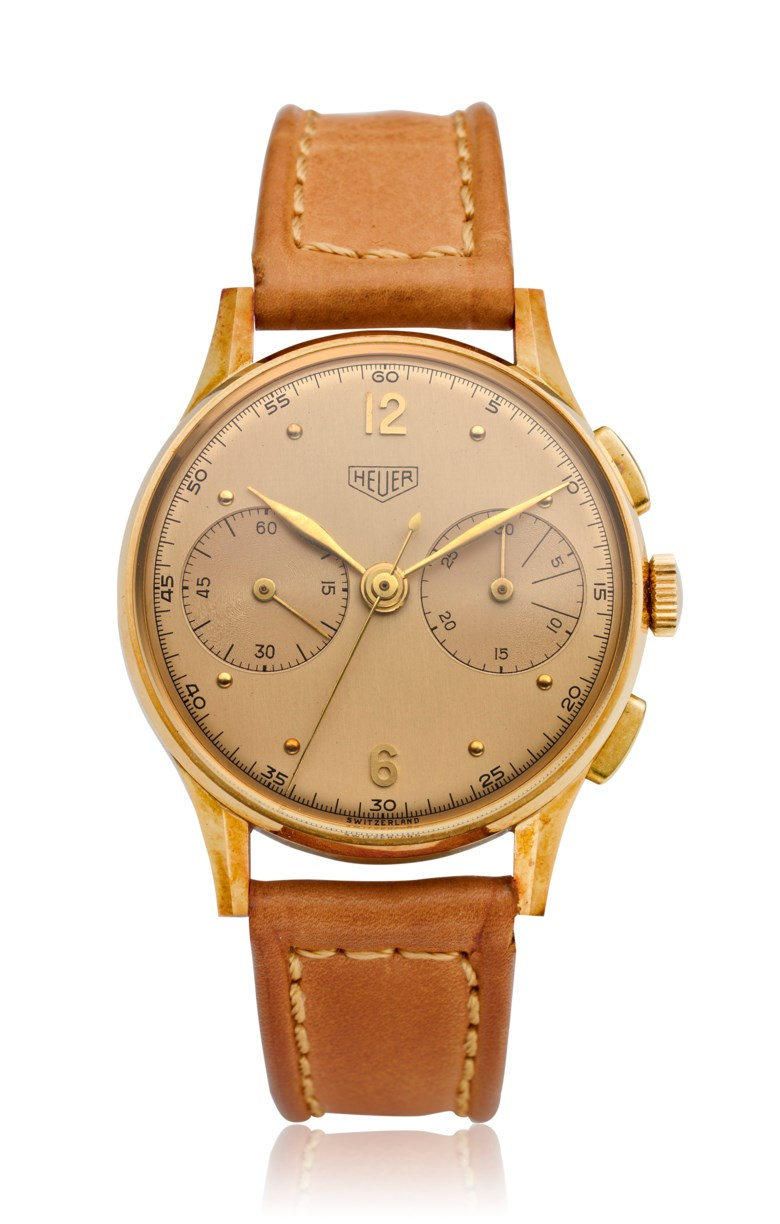 Heuer, exceptional new-old stock, 18k gold chronograph, ref. 418. Estimate $14,000-18,000. Offered in Watches Online Discovering Time, 1-13 October 2020, Online