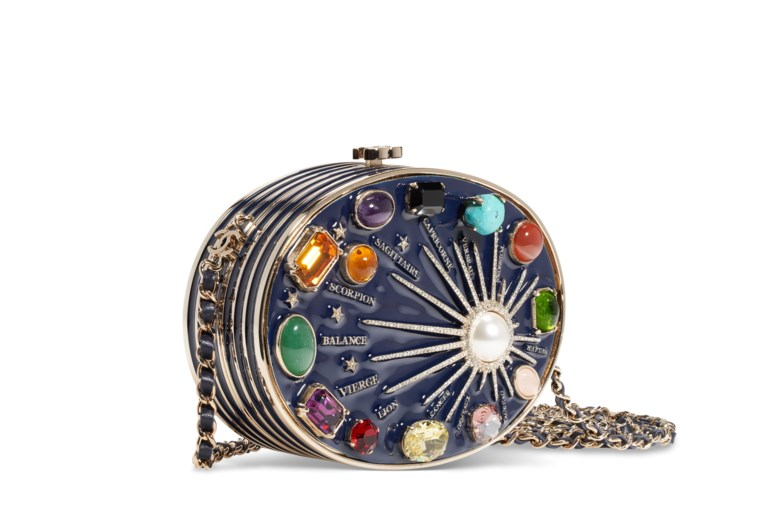 A Métiers dArt Paris-Monte Carlo runway blue enamel and stone Zodiac evening bag, Chanel, 2007. 13 w x 9.5 h x 4 d cm. Estimate $2,000-3,000. Offered in  Handbags & Accessories Online The New York Edition, 24 November to 10 December 2020, Online