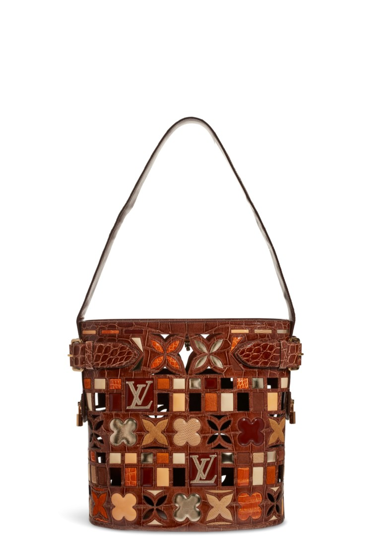 A Les Extraordinaires alligator & lizard maxi bucket with gold hardware, Louis Vuitton, SpringSummer 2006. 34 w x 35 h x 20 d cm. Estimate $4,000-6,000. Offered in  Handbags & Accessories Online The New York Edition, 24 November to 10 December 2020, Online