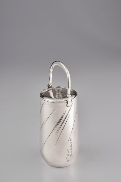 A SILVER EWER AND COVER