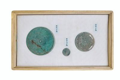 A GROUP OF BRONZE MIRRORS AND
