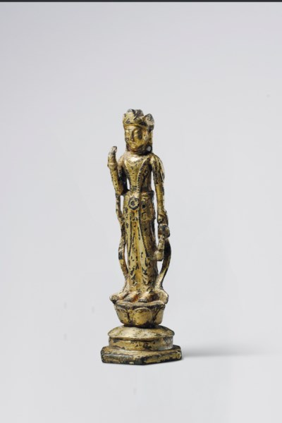 A GILT-BRONZE STANDING FIGURE