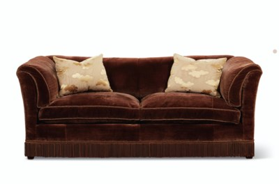 A BROWN VELVET UPHOLSTERED TWO