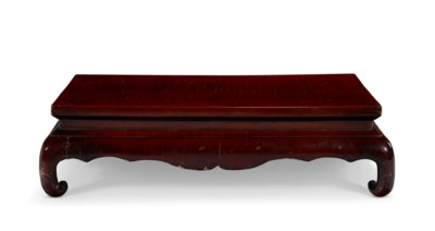 A CHINESE BROWN LACQUER KANG T